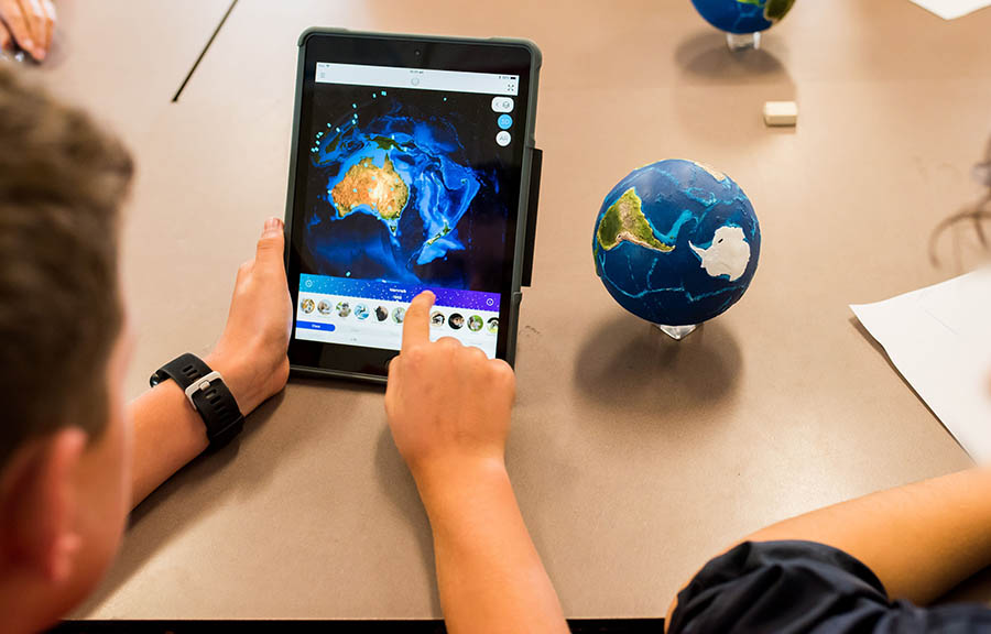 iPad with Globe and Map